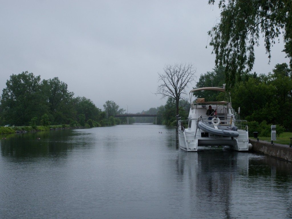 Most of the locks have picturesque facilities for overnighting, but some are much wetter than others (note the Captain dumping accumulated rainfall from aft cockpit cover).
