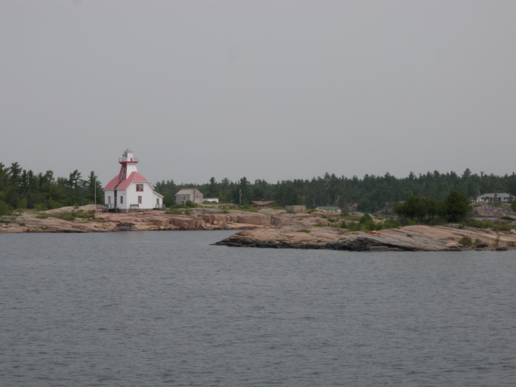 This is one of the many lighthouses/range markers critical to navigation along this section of the coast; without them it would be extremely difficult to locate the channel entrances amongst the   many rocks and low, uniform landscape of this portion of Georgian Bay.