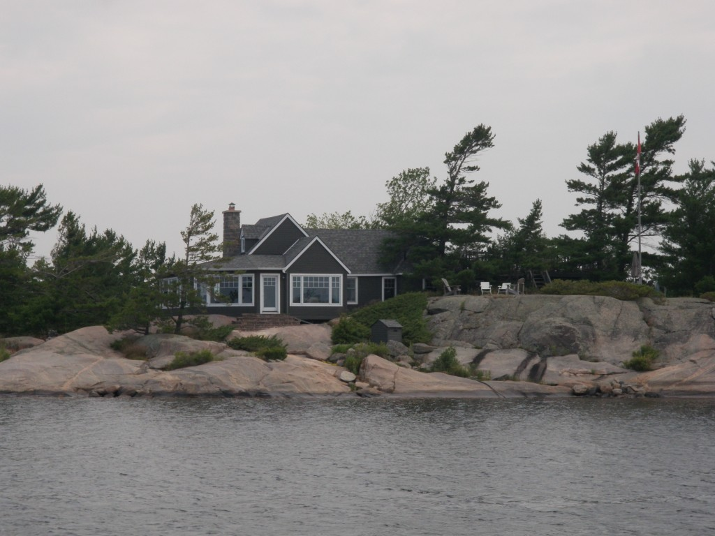 On our way to our first Georgian Bay anchorage at Longuissa Bay - this is typical of a 'three season' cottage, many on small, individual islands, spronkled all the way to Parry Sound.