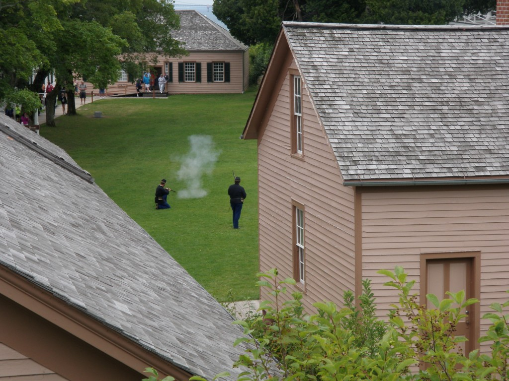 There's lots of activity at the fort - rifles firing, cannons booming, and bugles playing.