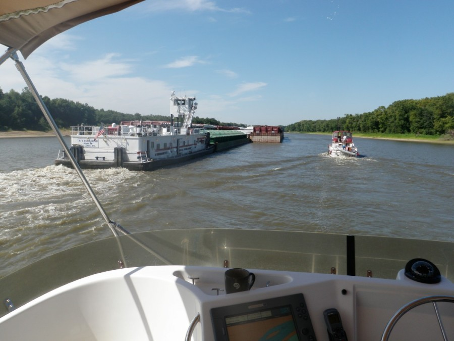 Passing a mid-sized tow along the Illinois; before overtaking, and sometimes head on where there is little maneuverability in narrow sections; it is common and wise practice to ask the tow captain 'one whistle or two?' to determine which side to pass.