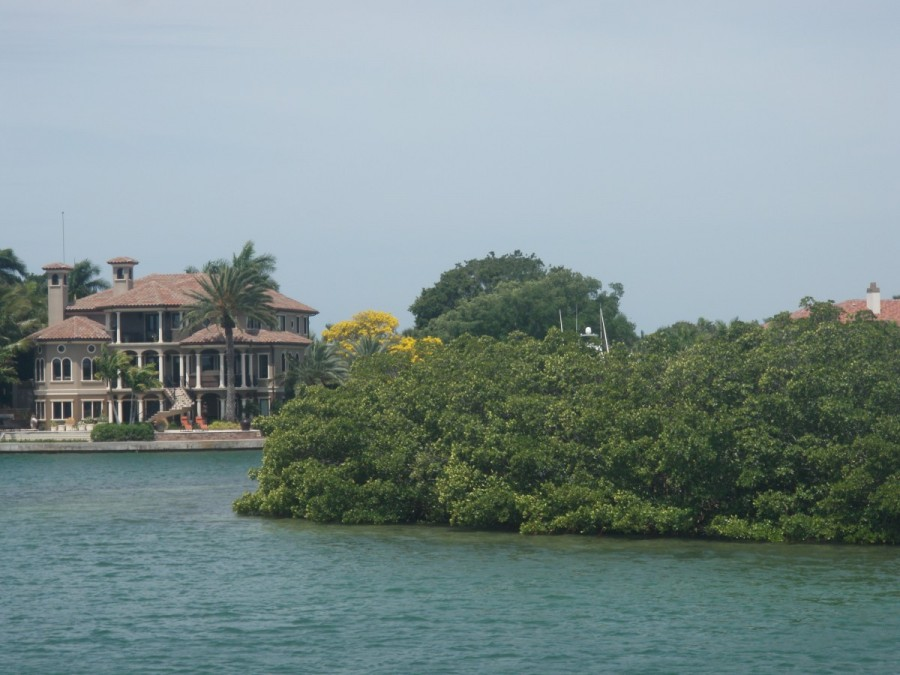 Our anchorage at Lido Key, a mix of high end homes and mangrove packed islets (dolphins included), vs. ......