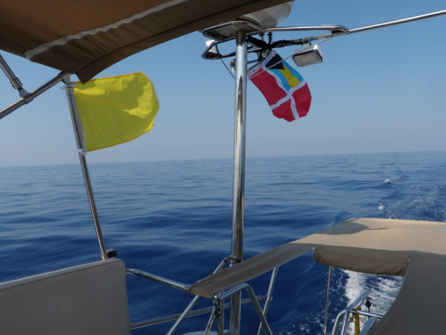 The 50 mile stretch of the Gulf Stream from Miami to Bimini can often be very rough, but ours was glass smooth; the flags are the quarantine (yellow, and flown until we clear customs) and Bahamas courtesy (flown while visiting the country).