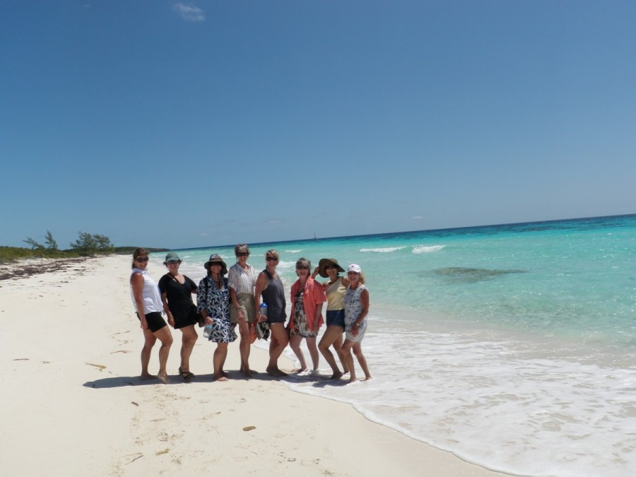 Some of the ladies out for a morning walk on the beach at Highborne Cay.