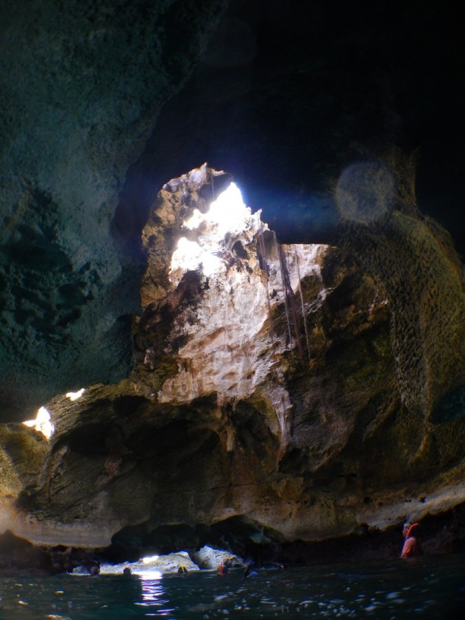 Natural light fills the grotto from overhead.