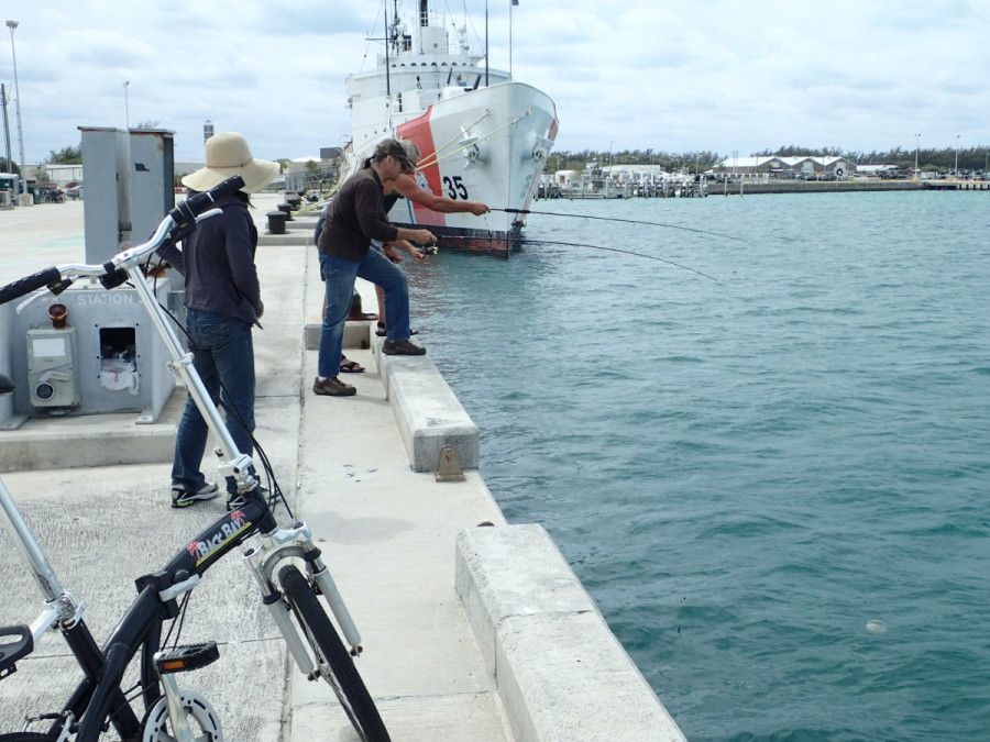 Fishing for the Captain's hat which blew into the harbour....