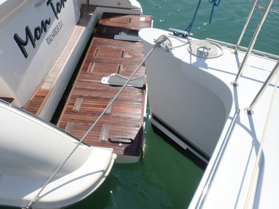 Up close and too personal with an Azimut 53 in No Name; unfortunately some slight damage was done to His Idea because of this guy's poor anchoring skills; to his credit, cash compensation to cover the cost of repair was successfully negotiated.