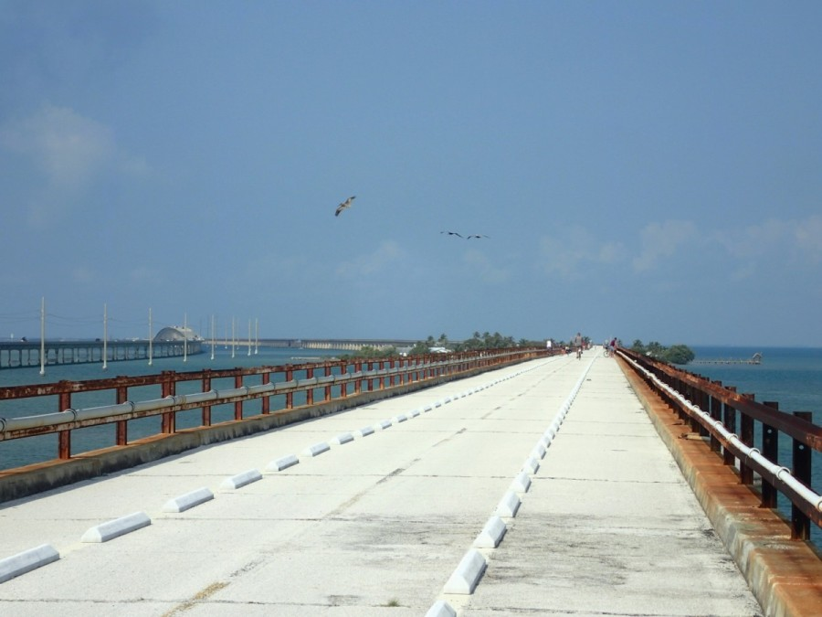 The Keys were linked  to the rest of Florida by the Overseas Railroad in 1912, a major engineering feat; much of it was destroyed by a major hurricane in 1935, to be replaced by the highway system in 1938; much of the old 'Seven Mile Bridge' is available for walking and cycling.