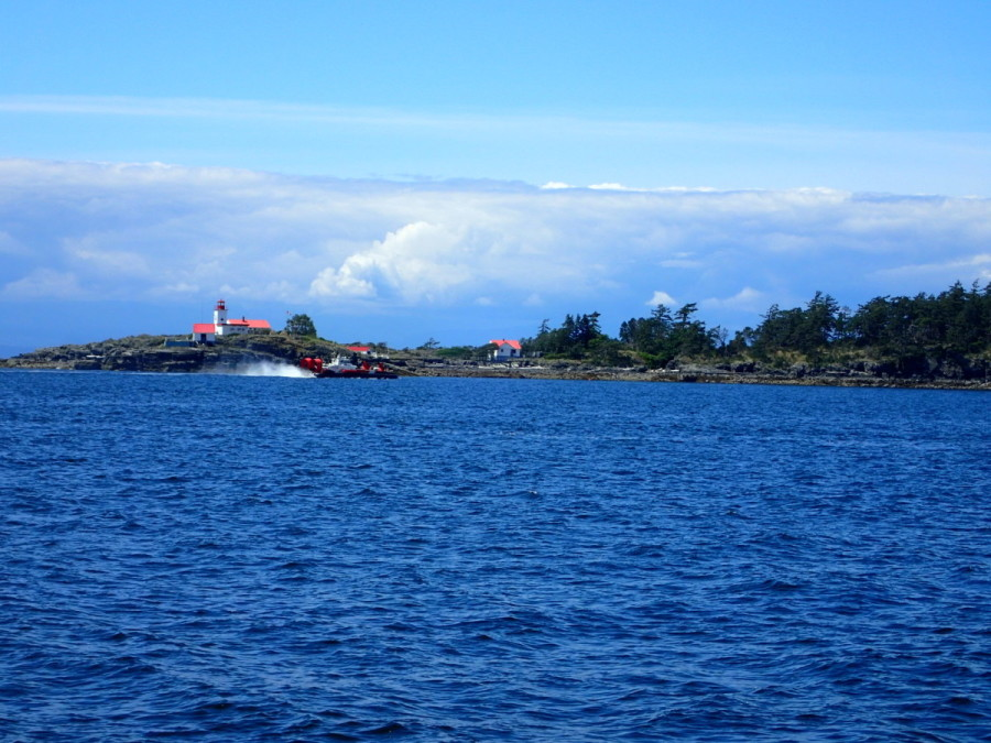 About 50 miles up Georgia Strait from our home port in Point Roberts is Merry Island Lighthouse, here about to be visited by Coast Guard hovercraft.