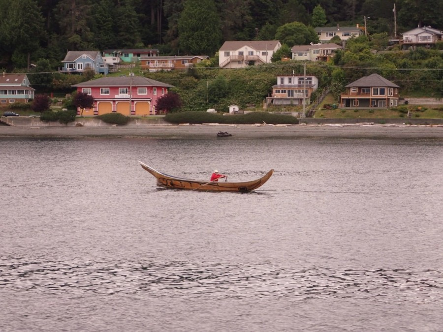 A carved native canoe in front of Alert Bay, a large First Nations community on Cormorant Island near port McNeill.