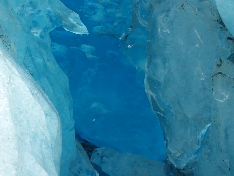 An ice at the bottom of the glacier; because the ice is densely packed it projects intense blue colours.